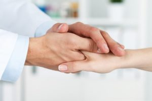 Doctor shaking hands with a patient