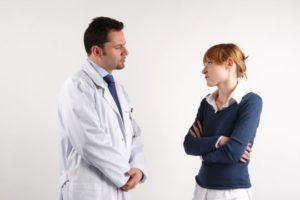 A Gynecologist speaking to a patient